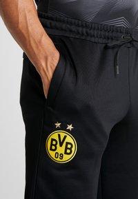 Puma - BVB BORUSIIA DORTMUND ICONIC TRACK - Teplákové kalhoty - puma black/cyber yellow - 3