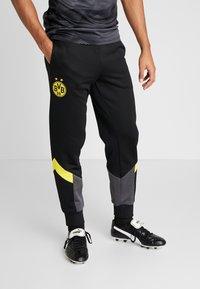 Puma - BVB BORUSIIA DORTMUND ICONIC TRACK - Teplákové kalhoty - puma black/cyber yellow - 0