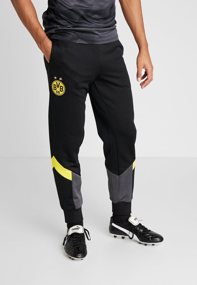 Puma - BVB BORUSIIA DORTMUND ICONIC TRACK - Teplákové kalhoty - puma black/cyber yellow