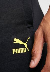 Puma - BVB BORUSIIA DORTMUND ICONIC TRACK - Teplákové kalhoty - puma black/cyber yellow - 5
