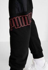 Puma - PUMA X DANIEL  FUCHS MAGIC FOX - Pantalon de survêtement - black - 5