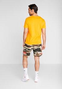 Puma - PUMA X DANIEL FUCHS MAGIC FOX - Sports shorts - multicolor - 2