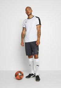 Puma - GRAPHIC SHORT - Sports shorts - black - 1