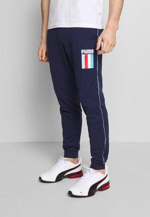 CELEBRATION PANTS - Teplákové kalhoty - peacoat