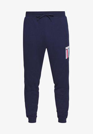 CELEBRATION PANTS - Pantalon de survêtement - peacoat