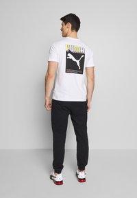 Puma - CELEBRATION PANTS - Tracksuit bottoms - black - 2