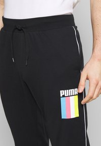 Puma - CELEBRATION PANTS - Tracksuit bottoms - black - 4