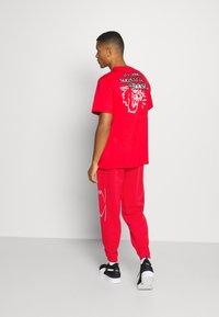 Puma - FRANCHISE - Pantalon de survêtement - high risk red - 2