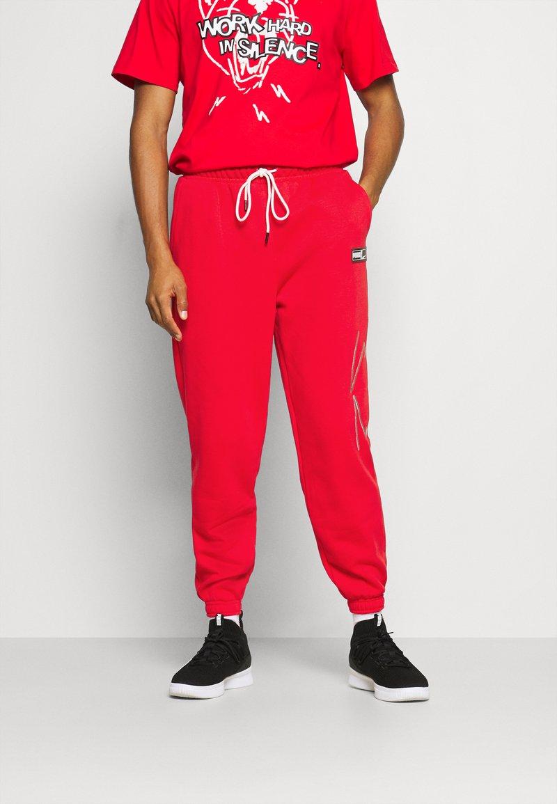 Puma - FRANCHISE - Pantalon de survêtement - high risk red