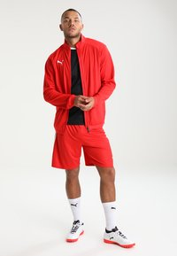 Puma - LIGA TRAINING JACKET - Trainingsvest - red/white - 1
