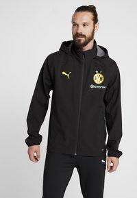 Puma - BVB BORUSSIA DORTMUND RAIN JACKET - Fanartikel - puma black/cyber yellow - 0