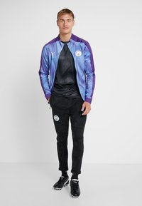 Puma - MANCHESTER CITY STADIUM LEAGUE JACKET  - Klubbkläder - tillandsia purple/light blue - 1