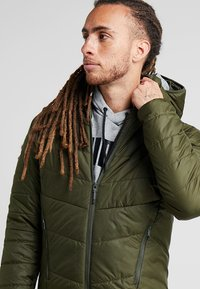 Puma - WARMCELL PADDED JACKET - Zimní bunda - forest night