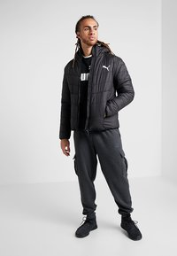 Puma - WARMCELL PADDED JACKET - Vinterjacka - black - 1