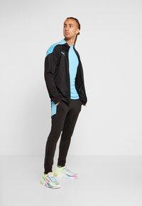 Puma - FTBLNXT TRACK JACKET - Training jacket - black/luminous blue - 1