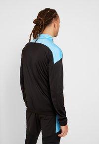 Puma - FTBLNXT TRACK JACKET - Training jacket - black/luminous blue - 2