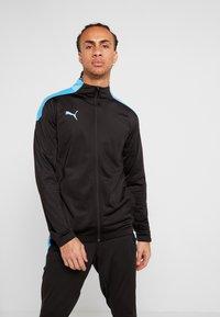 Puma - FTBLNXT TRACK JACKET - Training jacket - black/luminous blue - 0