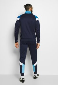 Puma - MANCHESTER CITY ICONIC TRACK  - Trainingsvest - peacoat/team light blue - 2