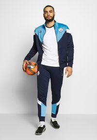 Puma - MANCHESTER CITY ICONIC TRACK  - Trainingsvest - peacoat/team light blue - 1