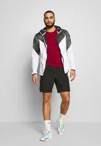 Puma - LAST LAP GRAPHIC JACKET - Sports jacket - puma white - 1