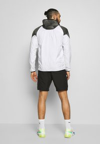Puma - LAST LAP GRAPHIC JACKET - Sports jacket - puma white - 2