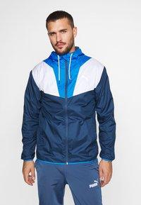 Puma - REACTIVE JACKET - Training jacket - dark denim/palace blue/white - 0