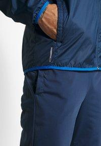 Puma - REACTIVE JACKET - Training jacket - dark denim/palace blue/white - 4