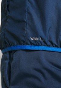 Puma - REACTIVE JACKET - Training jacket - dark denim/palace blue/white - 6
