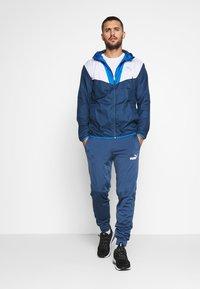 Puma - REACTIVE JACKET - Training jacket - dark denim/palace blue/white - 1
