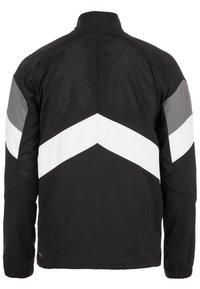 Puma - Sports jacket - black/white/castlerock - 1