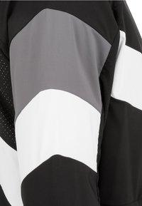Puma - Sports jacket - black/white/castlerock - 2