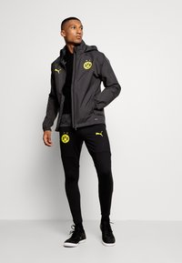 Puma - BVB BORUSSIA DORTMUND RAIN JACKET - Equipación de clubes - asphalt/cyber yellow - 1