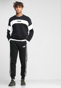 Puma - REBEL CREW - Sweatshirts - black - 1