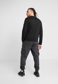 Puma - AMPLIFIED CREW - Sweater - puma black - 2