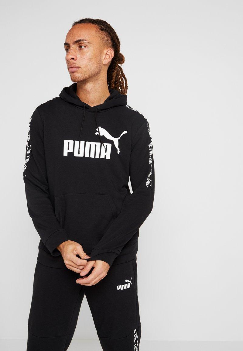 Puma - AMPLIFIED HOODY - Bluza z kapturem - black