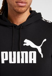 Puma - AMPLIFIED HOODY - Bluza z kapturem - black - 5