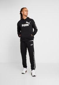Puma - AMPLIFIED HOODY - Bluza z kapturem - black - 1