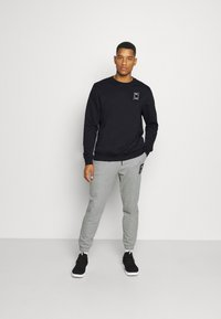 Puma - PIVOT CREW - Sweatshirt - black - 1