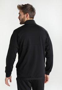Puma - LIGA SIDELINE TRACKSUIT - Dres - black/white - 2