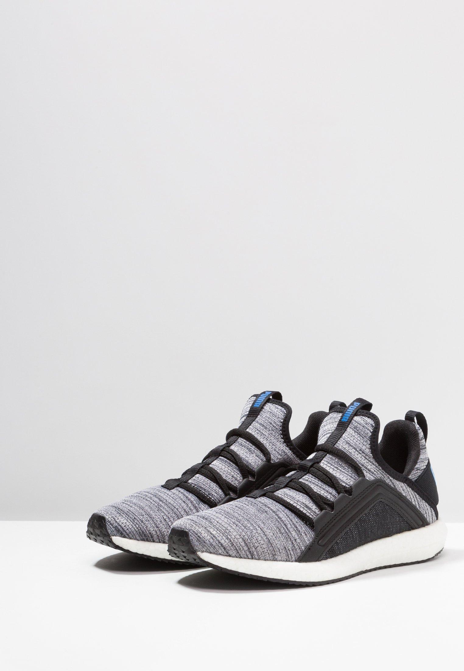 Puma MEGA NRGY - Neutral running shoes - black/white/indigo bunting