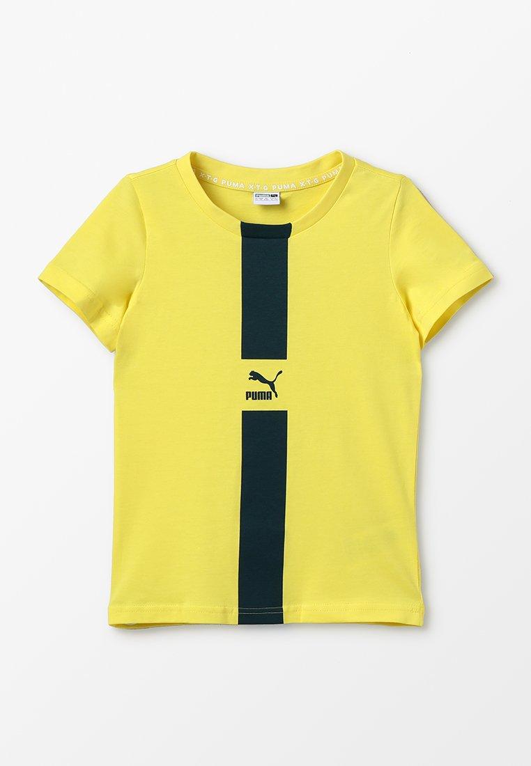 Puma - PUMA XTG TEE  - T-shirt print - blazing yellow