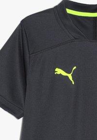 Puma - T-shirt z nadrukiem - ebony/yellow alert - 3
