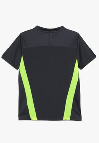 Puma - T-shirt z nadrukiem - ebony/yellow alert - 1