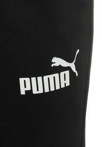 Puma - LOGO PANTS - Pantalon de survêtement - black - 2