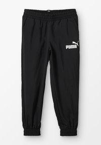 Puma - LOGO PANTS - Tracksuit bottoms - black - 0