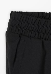 Puma - LOGO PANTS - Tracksuit bottoms - black - 2