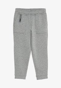 Puma - NUTILITY PANTS - Pantalon de survêtement - medium gray heather - 3