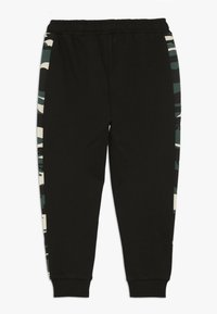 Puma - PUMA X ZALANDO TAPERED PANTS - Trainingsbroek - black - 1