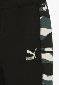 Puma - PUMA X ZALANDO TAPERED PANTS - Trainingsbroek - black - 3