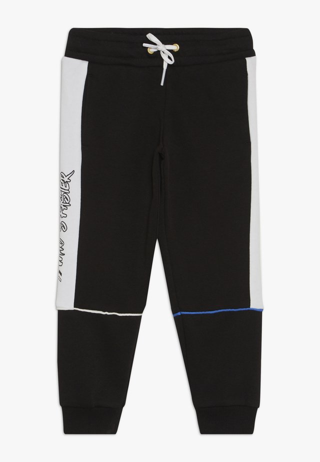 SEGA PANTS - Tracksuit bottoms - black